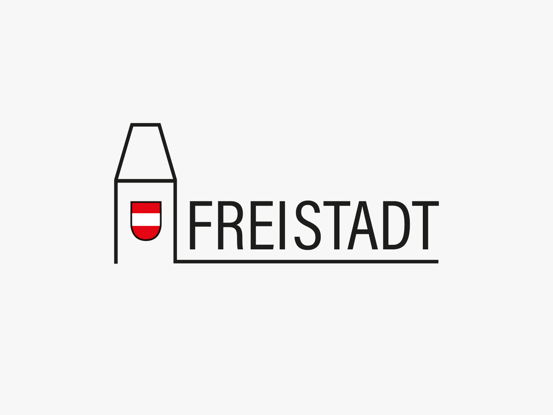 Logo von Freistadt mit dem Stadtturm skizziert in schwarz inklusive Wappen