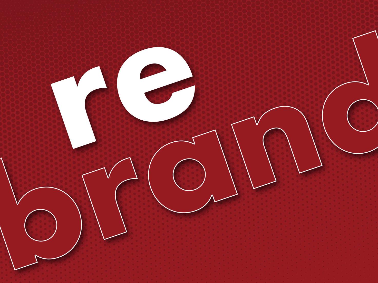 Rebranding steht in weißen und roten Buchstaben quer ueber das Bild geschrieben