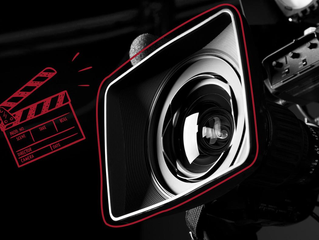 Kappe und Filmkamera symbobilisiert Video Marketing